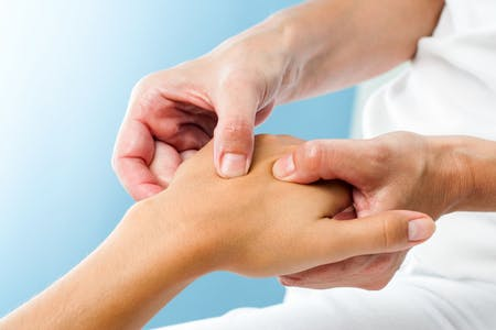 Regain Health Ltd - A hand therapist at work providing theraphy for the fore arm